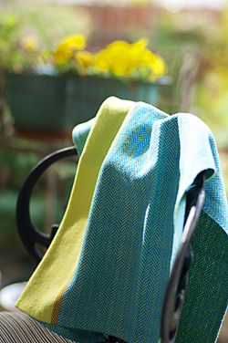 Sunshine on my Shoulders kitchen towel draped on a chiar