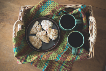 towel on a tray with tea & scones