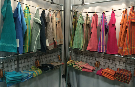 Whimsy & Tea towels hanging in my booth
