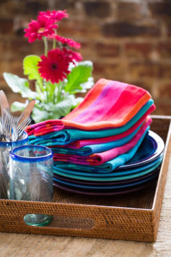 multicolored handwoven napkins and plates